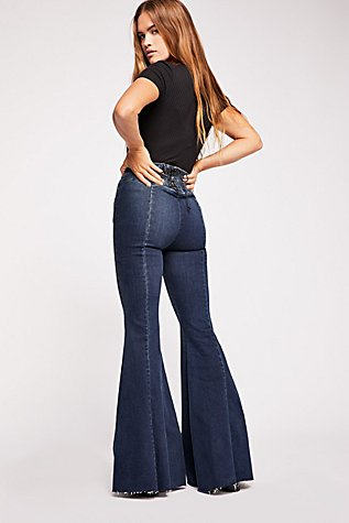 CRVY Super High-Rise Lace-Up Flare Jeans | Tuggl