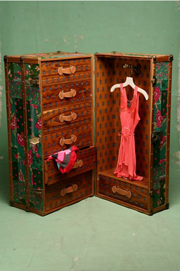 A more feminine interpretation of the classic early 1920's steamer trunk. Brightly colored patchwork quilts cover the outside, while the inner drawers are lined with beautiful hot pink satin and decor