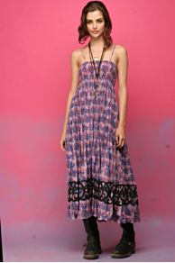 Printed woven maxi dress with smocked bodice and adjustable straps.