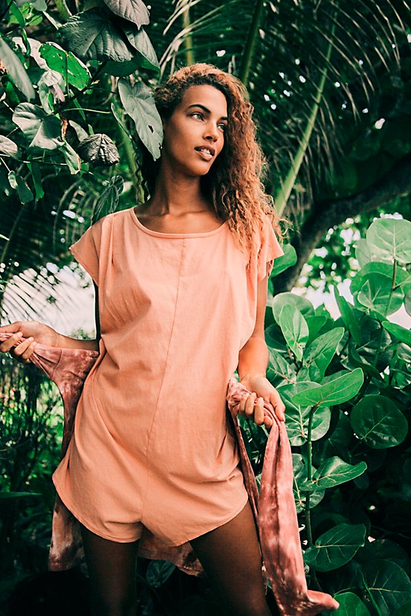 American made romper featuring a keyhole cutout at the back with button closure. Oversized, shapeless silhouette and lightweight cotton fabrication make for an effortless wear.