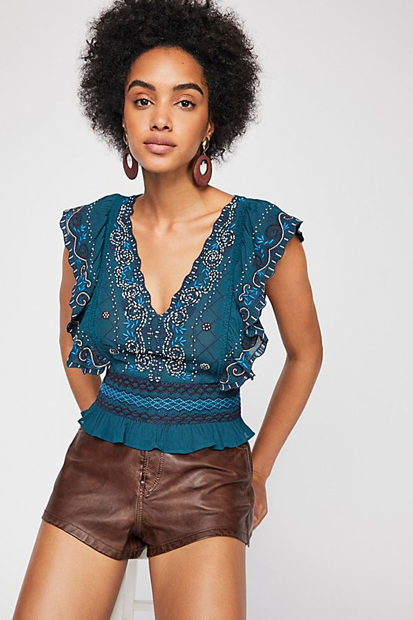 Gorgeous embroidered top with ruffled sleeves