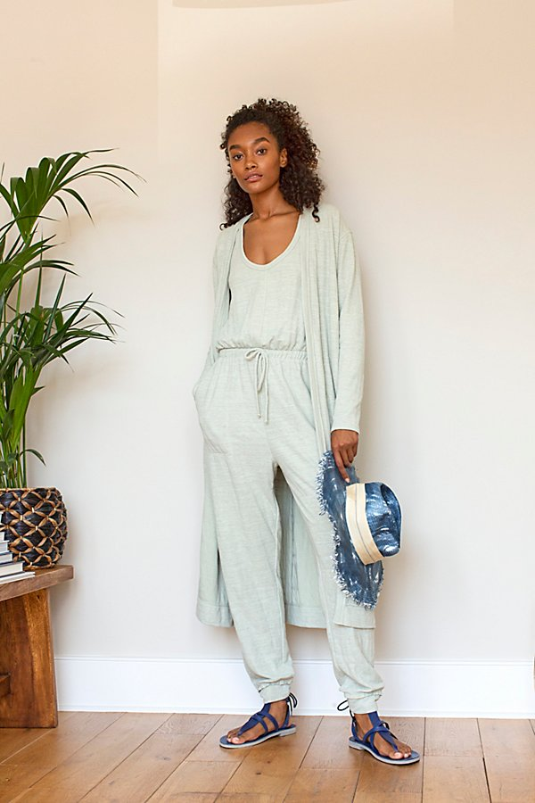 Easy knit set from our FP Beach collection featuring a jumpsuit and matching cardigan*Jumpsuit:* Tank top Drawstring waistband Tapered legs Blousy design *Cardigan:* Slim fit Long sleeves Open front Midi length