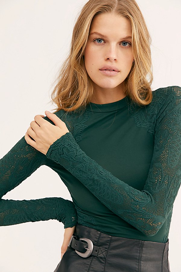 Mock neck long sleeve top featured in our signature Seamless fabric with mesh trim accented by an embroidered floral design* Stretch fit* Sheer sleeves and trim* American made