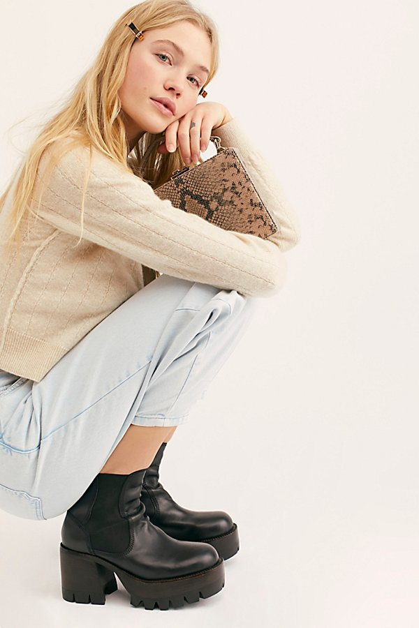 Statement platform ankle boots part of an exclusive collaboration with Jeffrey Campbell and Free People. * Padded footbed* Inside zip closure* Treaded rubber outsole* Elastic sidegoring