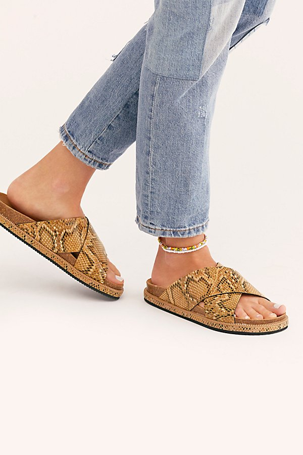Spanish-made faux snakeskin sandals featuring wide crisscross straps and a contoured footbed* Slip-on style* Stepped sole* Comfortable design*Fit Note:* This style runs true to size. If between sizes, we suggest sizing up.