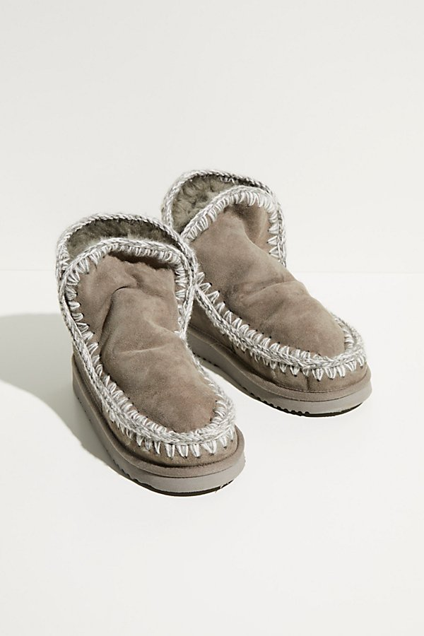 Coziest soft sheepskin boots featuring a shearling lining and crochet stitching in an ankle-high rise* Pull-on style* Soft sole* Split top edge