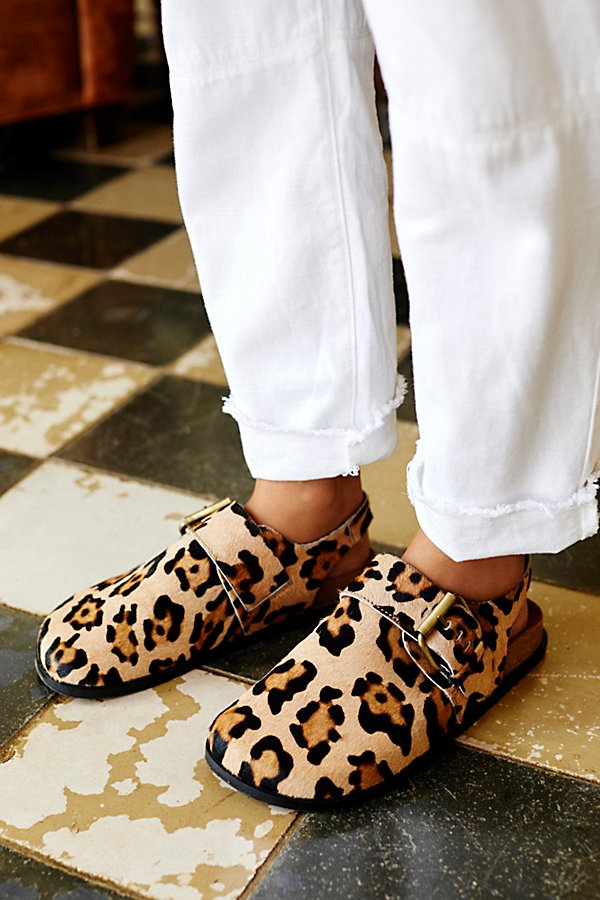 Printed slip-on clogs featuring a slingback strap and belted accent with a textured cow hair design* Adjustable belted strap* Molded footbed* Round, covered toe*Fit Note:* This style runs true to size. If between sizes, we suggest sizing up.