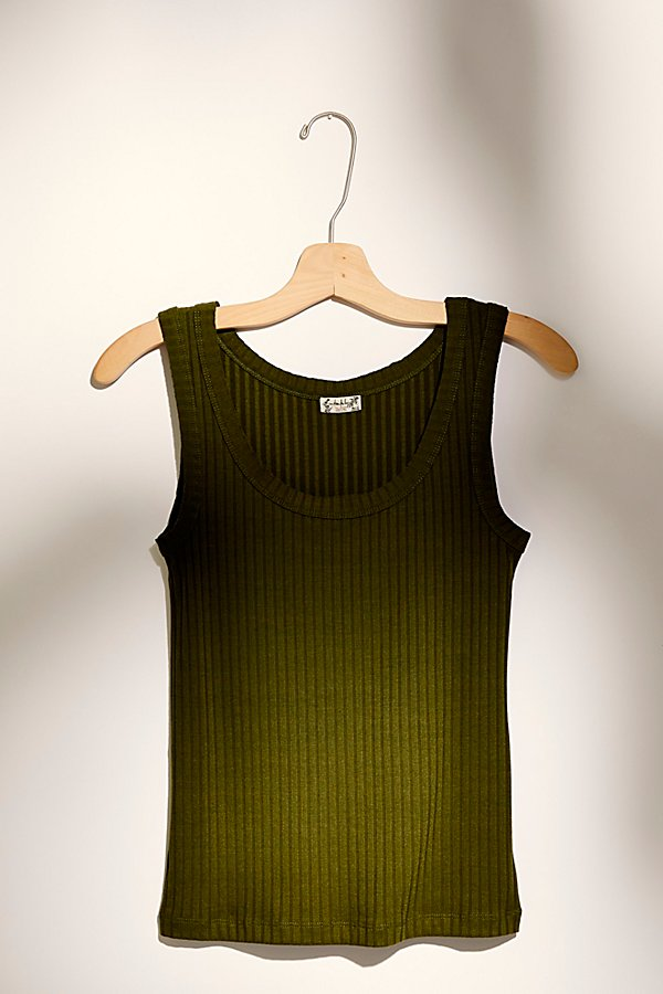 Essential ribbed tank featuring a scoop neckline and raw edge hems* Relaxed fit* Stretch fabric* Knit design