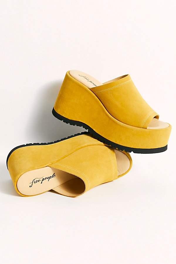 Spanish-made sky high chunky platform sandals featured in a slip-on retro design* Cushioned footbed* Lugged sole*Fit Note:* This style runs true to size. If between sizes, we suggest sizing down.
