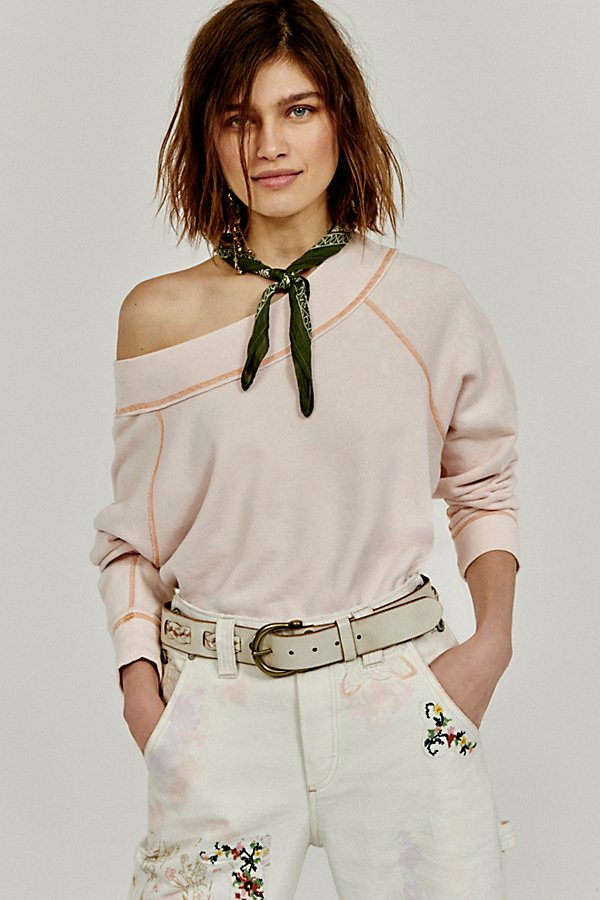 Distressed leather belt featuring braided details woven throughout and a horseshoe-shaped buckle* Adjustable fit* Can be worn on hips or waist