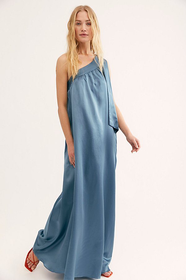 This silky maxi dress designed in a shapeless silhouette features a one-shoulder bow tie strap and gathered-pleat detailing from neckline. * Hip pockets* Effortless pull-on style* Dropped armhole