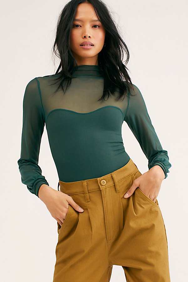 Mock neck mesh layering top pieced with a ribbed faux tube featuring a sweetheart neckline* Billowy sleeves* Ribbed cuffs* Stretch fit