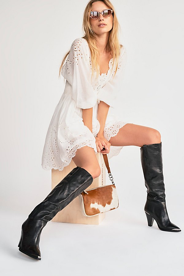 Gorgeous crocodile-inspired high-knee boots in a wide style with a pointed toe and kitten heel. * Pull-on style* Metal detail at toe and heel*Fit Note:* This style runs true to size. If between sizes, we suggest sizing up.