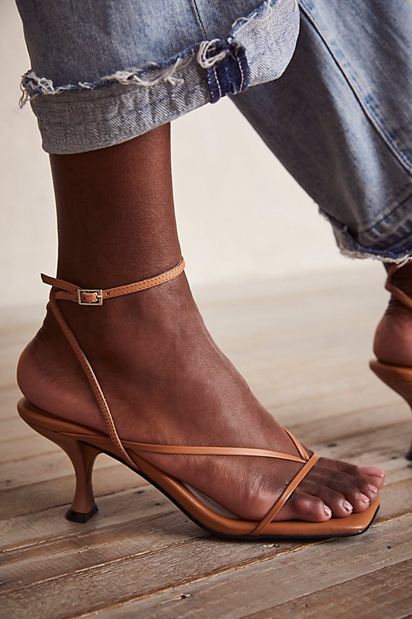 Step out in these barely-there strappy heels from Jeffrey Campbell, featured in a slim design with an angular, square toe* Adjustable ankle strap* Cushioned footbed* Flared heel