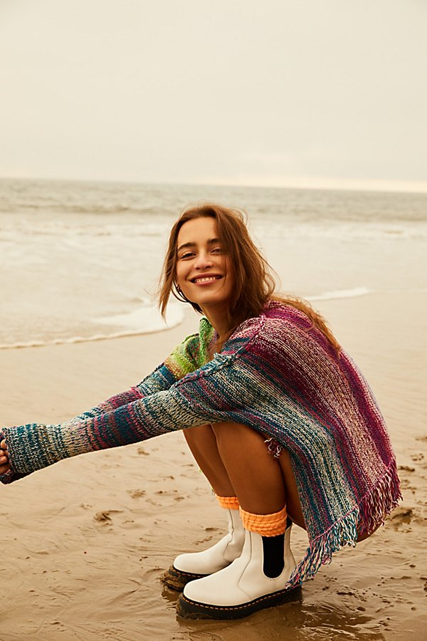 Cool and cozy pullover designed in a multicolored knit fabrication with dropped dolman sleeves and bottom fringe detail in a boxy, slouched silhouette. * Effortless pull-on style* Exaggerated side slits* Wide neckline feature