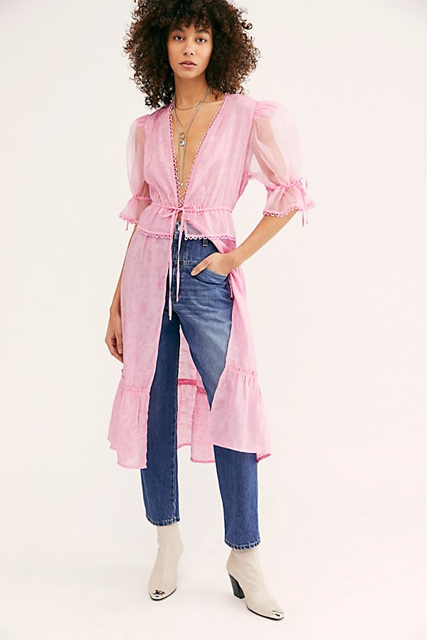 Designed exclusively for Free People, this RAHI Cali kimono features a gorgeous flowing design with sparling floral embroidery and puffed chiffon sleeves* Ties at waist* Loop eyelet trim * Slits on each side