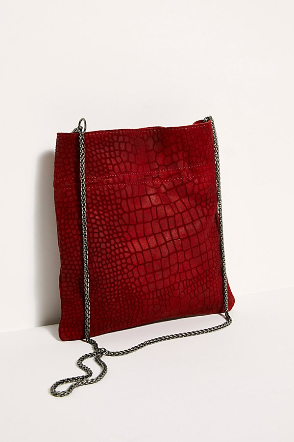 Great for a night out to carry your essentials, this slim crossbody bag is featured in a soft suede design with a thin chain strap* Adjustable interior* Lined design* Open front