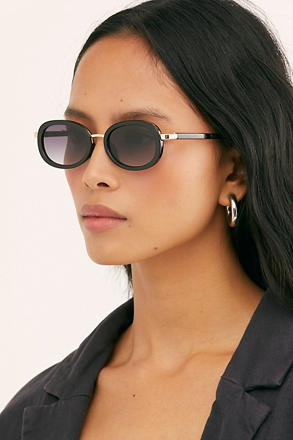 Block the sun in these chic, bold framed sunnies featured in an oval silhouette and gradient tinted lenses* Gold hardware* Small frame