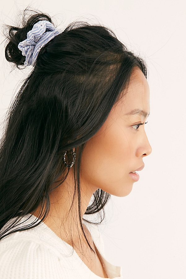 Tie up your tresses in this so pretty patterned scrunchie featuring delicate crochet insets.