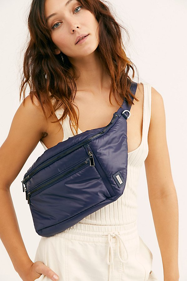Inspired by the clouds, this light as air sling bag from Caraa is featured in waterproof nylon with eight pockets, and can be worn as a belt bag or crossbody sling* Four zipper compartments in front* Two zip compartments in back* Adjustable waistbelt* Two external d-rings to hook items onto* Two interior zipper pockets* Key fob