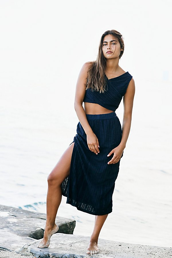 Perfect no matter the season, this effortless set from our FP Beach collection features a cross-front cropped tank and high-rise midi skirt in a ribbed knit fabrication. *Top: V-neckline* Dropped armholes* Criss cross design*Skirt: Elastic waistband* Side slit * Body-hugging fit