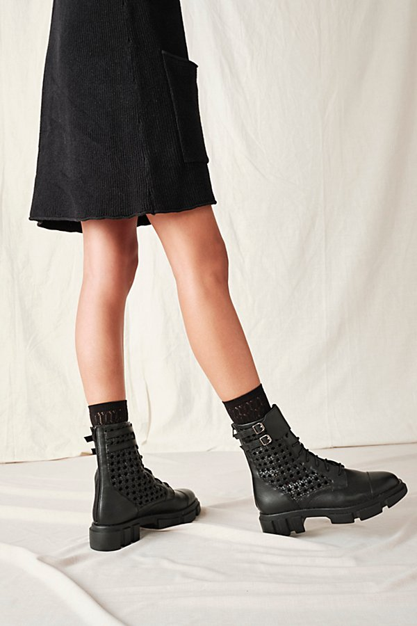 Make a statement in these bold platform ankle boots featured in a cool leather design with perforated details, a chunky sole and a wide ankle strap* Lace-up front* Cushioned insole* See-through detailing