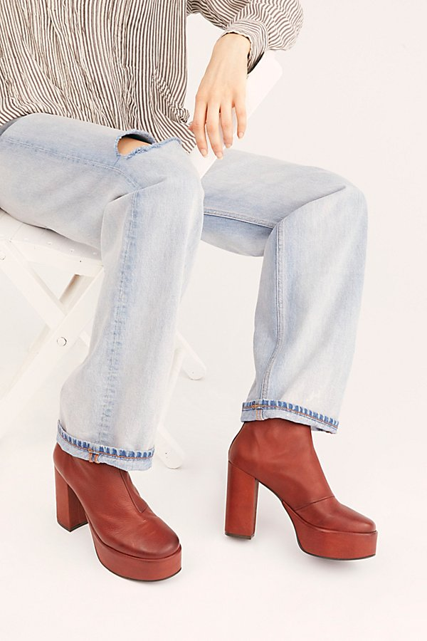 Make a statement in these so retro chunky platform boots featured in a sleek leather style with a slim, sleek fit* Back zipper closure* Cushioned insole* Spanish made