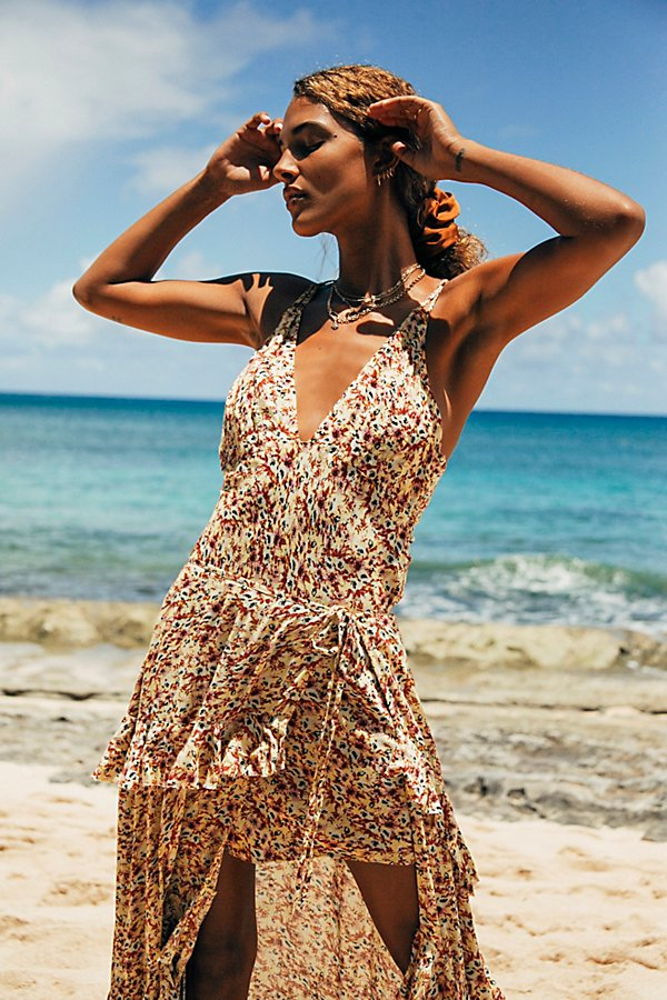 So gorgeous worn separate or together, this eye-catching slip set features a floral mini slip with a dramatic tiered maxi skirt that effortlessly pulls over*Slip:* Plunging V-neckline Crisscross strappy back Relaxed fit *Skirt:* Slit up the side Tiered ruffled details Pull-on high-rise style