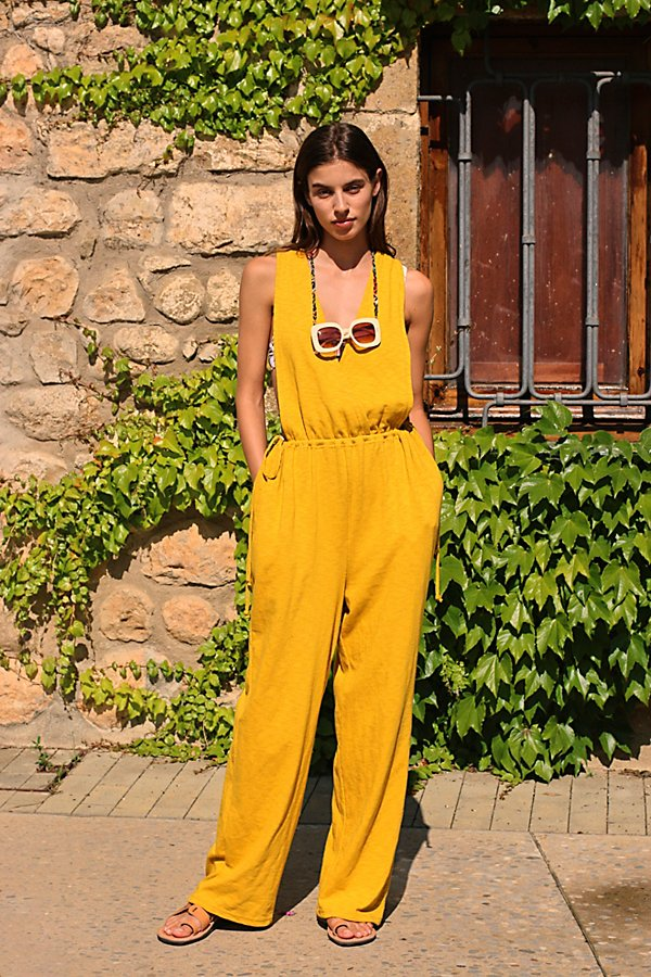 An effortless essential from our FP Beach collection, this goes-with-anything jumpsuit is featured in a wrap-front silhouette with exaggerated dropped armholes and exposed back for added shape* Wide leg style* Drawstring waist* Side pockets