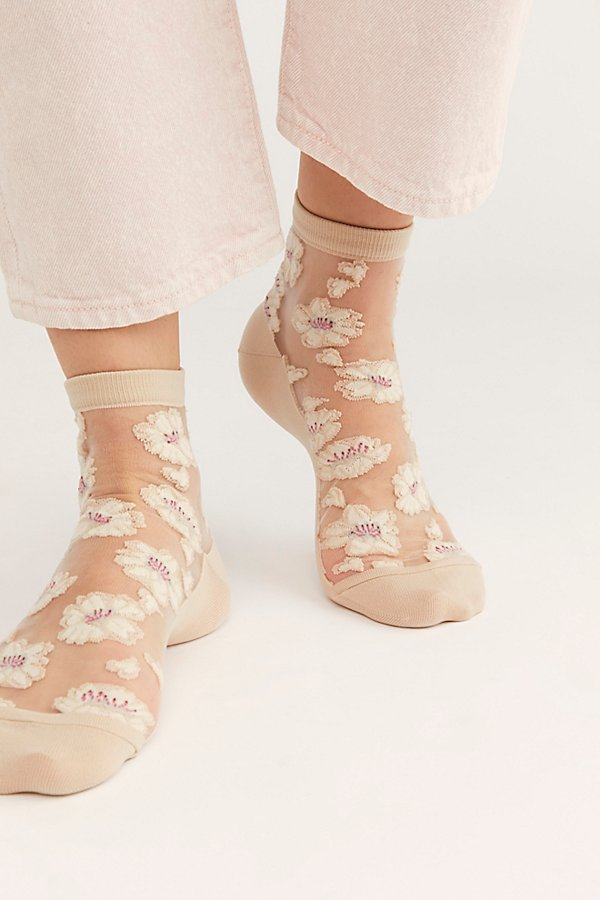 Add a sweet touch to your shoes with these sheer ankle socks featuring a fun floral print and comfy knit bottom* Lined trim* Stretch fit