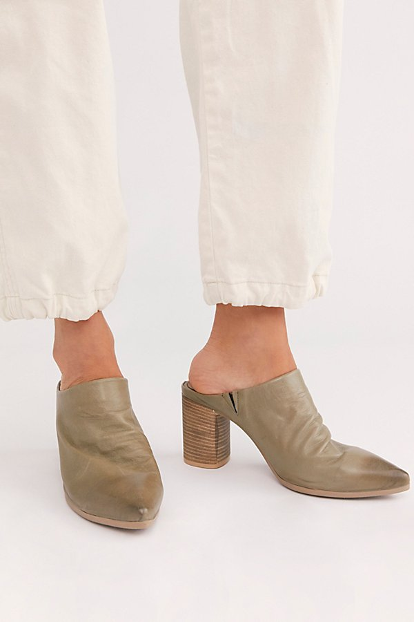 Take your look to new heights with these gorgeous leather mules featured in a high, stacked heel design with distressed detailing and a pointed toe* Slip-on style* Cushioned insole* Block heel