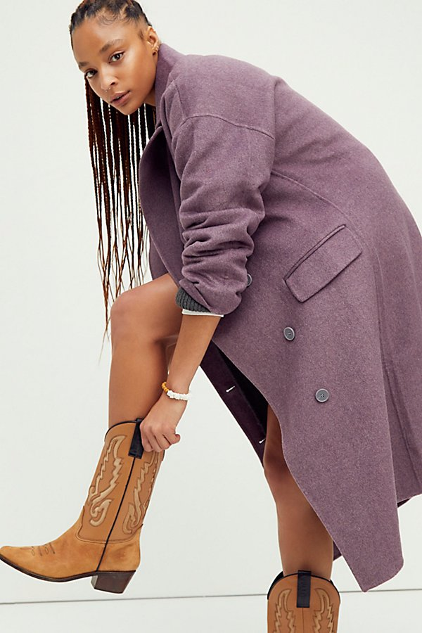 Stay warm and in style all season long in this staple, longline coat designed in a gorgeous wool fabrication for forever timeless style*Fit note:* This style is designed in an oversized silhouette, for a truer fit we suggest sizing down.