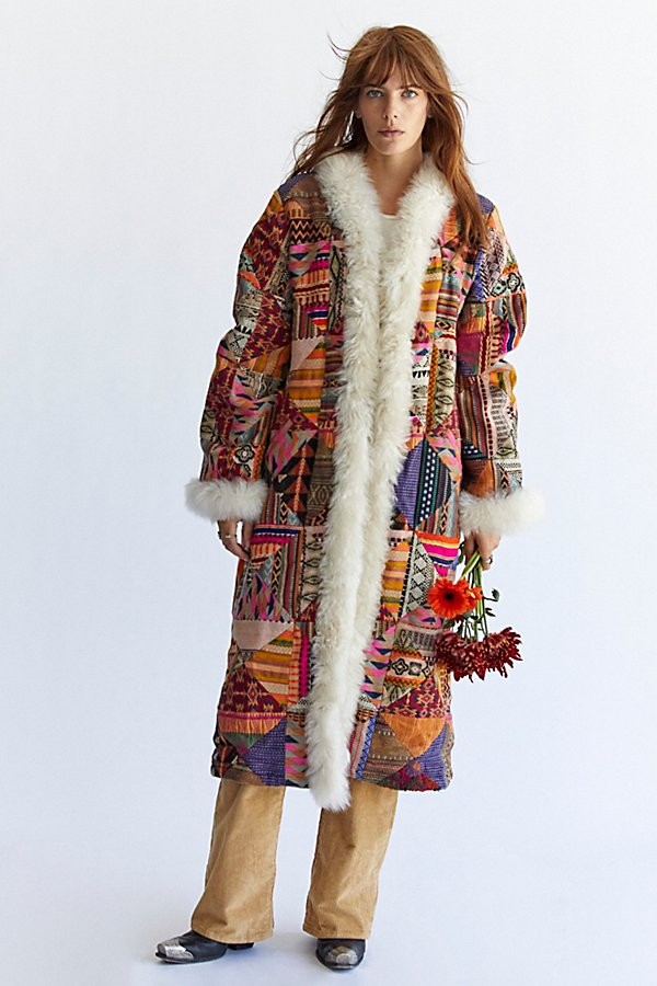 Stand out in this so special printed coat featured in a classic, longline silhouette with shearling trim at hems for added timeless dimension.
