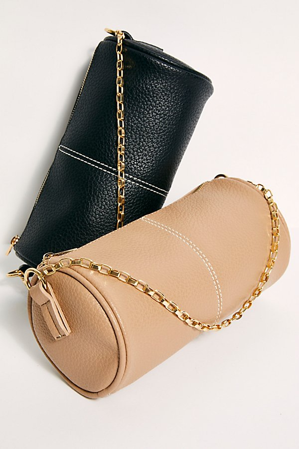 So chic faux leather shoulder bag featured in a cylindrical design with a linked chain strap and an adjustable shoulder strap* Top zipper closure* Adjustable belted strap* Back zipper pocket
