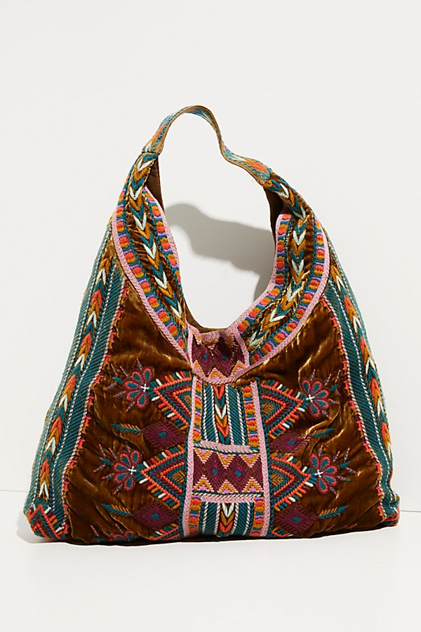 Carry it all in this gorgeous slouchy tote featured in a printed, soft velvet design with contrasting patterned straps and an oversized style* Open top* Velvet lined interior* Continous shoulder strap