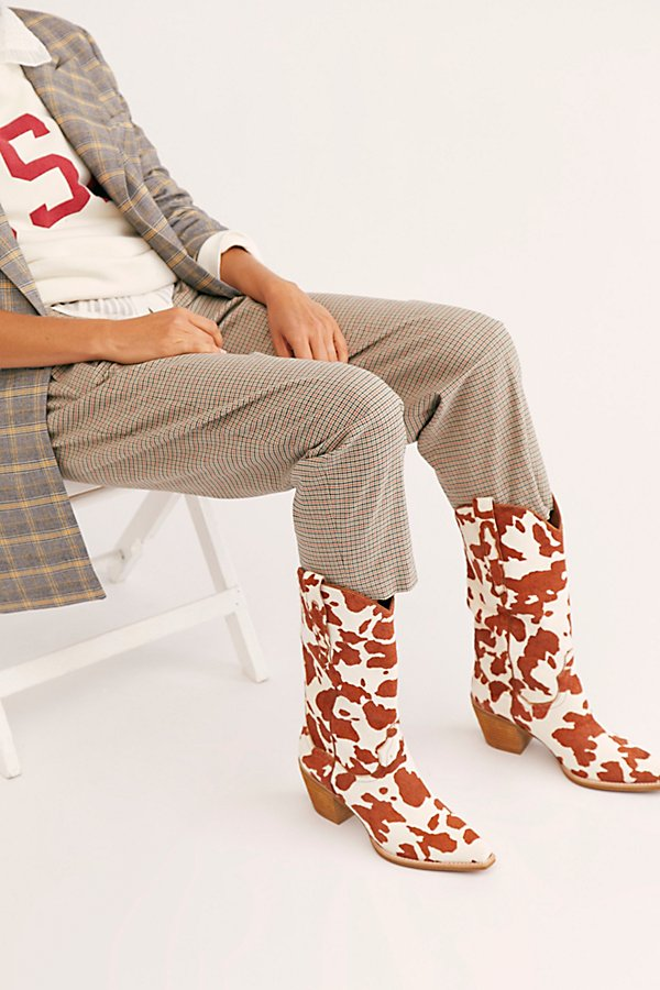 The coolest western-inspired boots from Jeffrey Campbell get an update in a printed cow hair style featuring classic embroidered details with a pointed toe and block heel* Pull-on style* Cushioned insole* Classic rounded edge* Pull tabs on either side