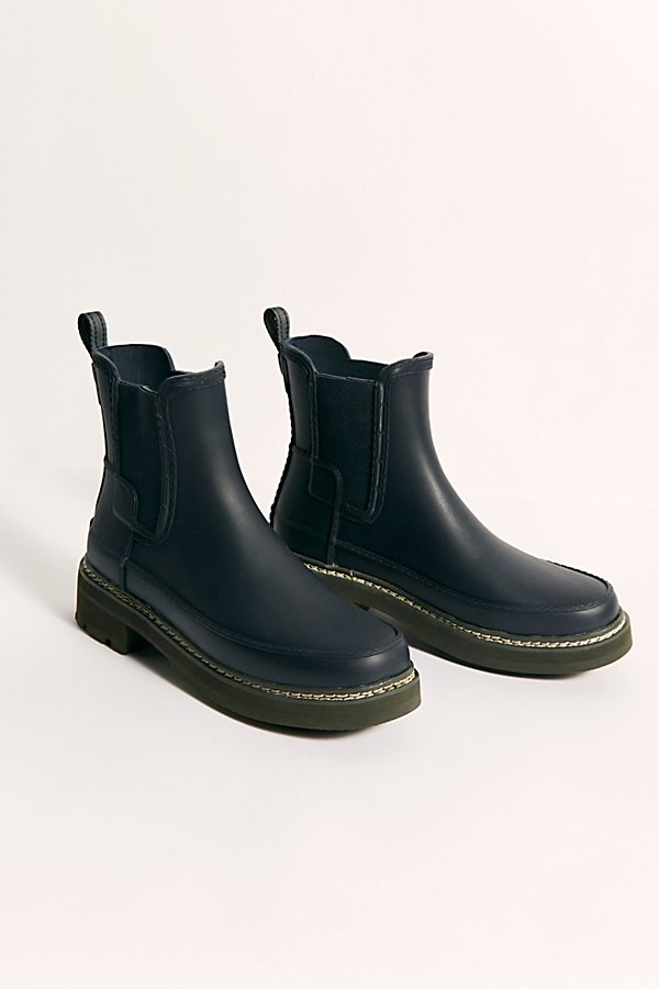 Step up your rainy day style with these so cool rain boots featured in a Chelsea boot-inspired ankle-high silhouette with a chunky EVA outsole* Elastic side gussets and nylon pull-tab for ease of foot entry* Crafted from natural vulcanized rubber with matte finish* Welted stitch detail on outsole
