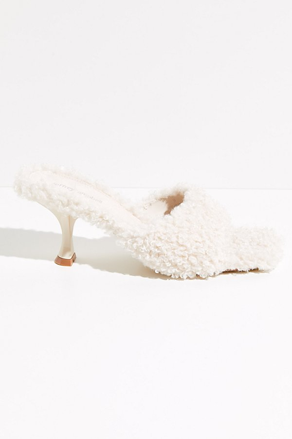 Make a statement in these so fun slip-on heels from Jeffrey Campbell featuring a bold shearling-covered design with an architectural square toe and soft lining* Slip-on style* Sculpted heel* Cushioned insole