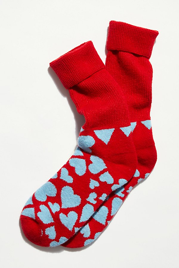 Make a statement in these so fun and cozy socks featured in a ribbed, calf-high style with a smiley face pattern on the foot* Solid toe and heel* Thick knit