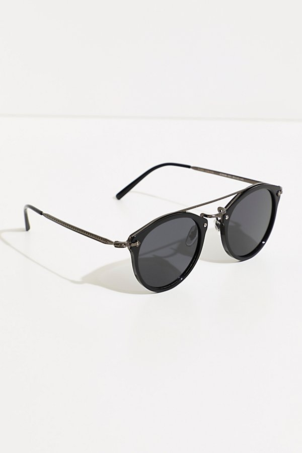Stay shaded in these so cool round-frame sunnies featured in an aviator style with a thin brow bar and polarized lenses* Tort design* Lightweight style