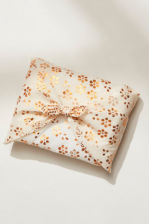 A unique and sustainable way to wrap your gifts, this cotton fabric gift wrap features a metallic pattern design that easily ties around any medium-sized present* Free People logo* Lightweight fabric* 30\\\