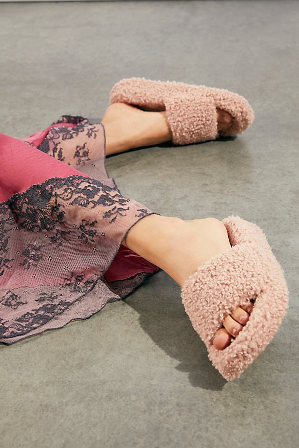 A collaboration between Jeffrey Campbell and Free People, these so fluffy slippers are featured in a teddy bear faux fur design* Slip-on style* Sandal silhouette* Cushioned footbed