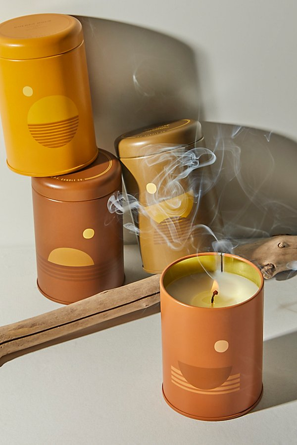 These so special candles from P.F. Candle Co. are poured into custom-printed tin vessels donned with earth-toned motifs, sun shapes, and horizon lines inspired by California scenery. Available in four nostalgic scents meant to represent times of day and the feelings they spark within us. Swell: 12pm. Salty skin, steady tides, endless afternoons in the hot summer sun. Vibrant, juicy, aquatic. Black currant, tuberose, and sea moss. Golden Hour: 5pm. Rustling grasses, baked earth, sun rays split between trees. Mellow, dry, tranquil. Bergamot, hay, and golden poppy. Dusk: 8pm. Damp leaves, crisp air, powder and spice on a clear night. Woody, cool, and earthy. Black pepper, clary sage, palo santo, and blooming iris. Moonrise: 12am. Heatwaves, late-night crowds, the lure of the dance floor melding smoke and strange perfumes. Balmy, ambiguous, free. Yuzu, Indian jasmine, and smoked cedarwood* 10 oz* 3\\\